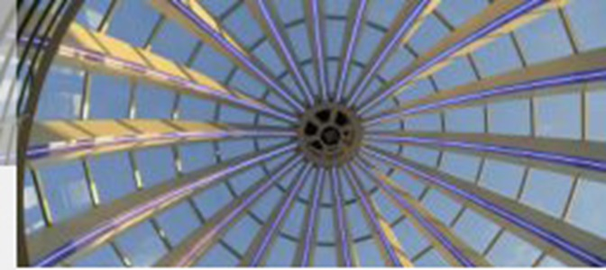Perspective view through the glass dome of the Executive Campus HSG towards the blue sky.